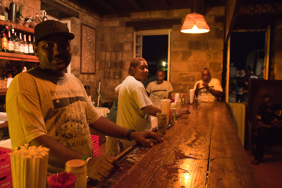 Bar on Shirley Heights, Antigua island, Antigua and Barbuda, Caribbean. Black barrens. Бар на Ширли Хайтс, остров Антигуа, Антигуа и Барбуда. Два чёрных бармена-негра.