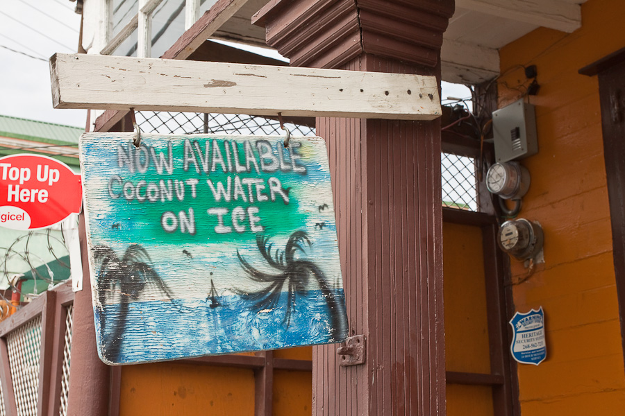 Now Available Coconut Water on Ice old vending sign, St. John's city, Antigua island, Antigua and Barbuda, Caribbean. Старая вывеска на улице города Сент-Джонса, остров Антигуа, Антигуа и Барбуда, Карибский бассейн.