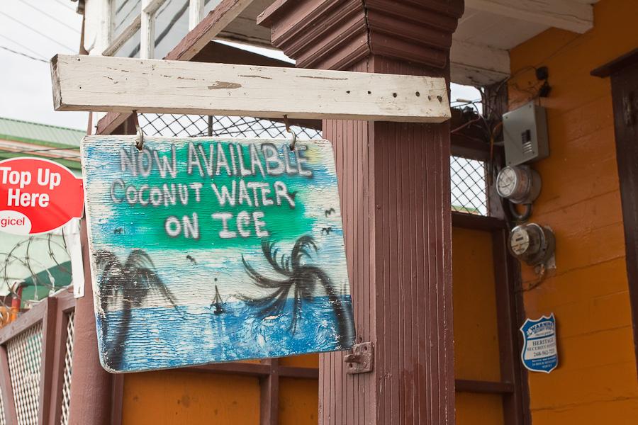 Now Available Coconut Water on Ice old vending sign, St. John's city, Antigua island, Antigua and Barbuda, Caribbean. Старая вывеска на улице города Сент-Джонса, остров Антигуа, Антигуа и Барбуда, Карибский бассейн.