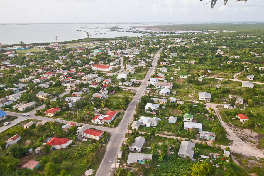Codrington town aerial view, Island of Barbuda, Antigua and Barbuda, Caribbean. Город Кодрингтон, аэрофотосъека с самолёта, остров Барбуда, Антигуа и Барбуда.