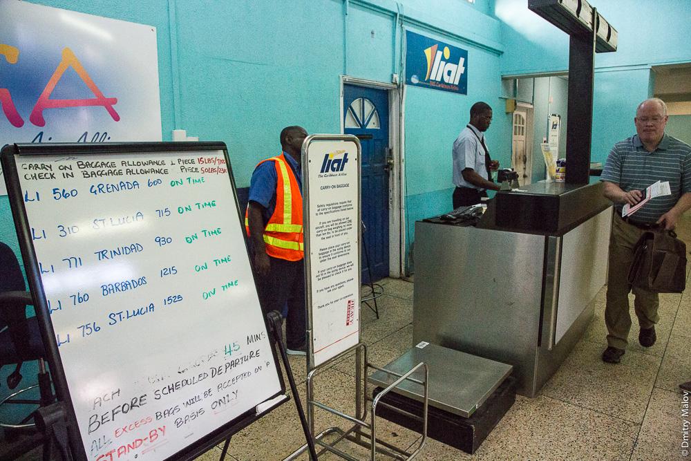 Inside E.T. Joshua Airport (IATA: SVD, ICAO: TVSV), расписание авиакомпании Liat маркером на доске, airline schedule on a whiteboard