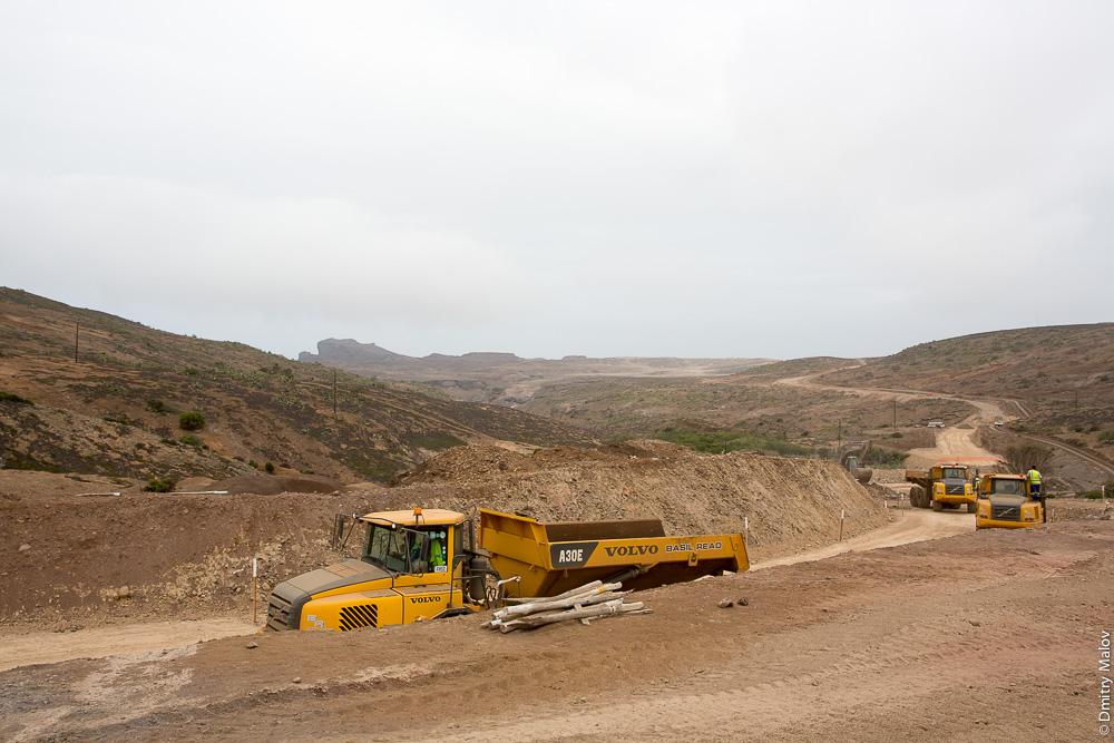 Saint Helena island Airport construction field, vehicles. Машины-самосвалы на строительстве аэропорта острова Святой Елены.