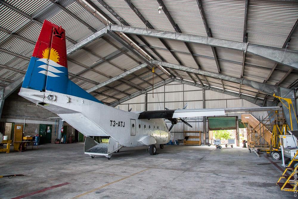 T3-ATJ (Air Kiribati) CASA C-212 Aviocar inside hangar with elevating rudder dismantled, Tarawa