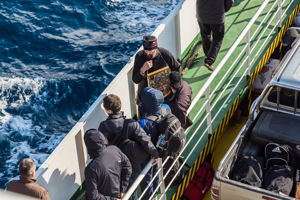 Монах на борту парома на Святую Гору Афон. Monk on board the ferry to Mount Athos