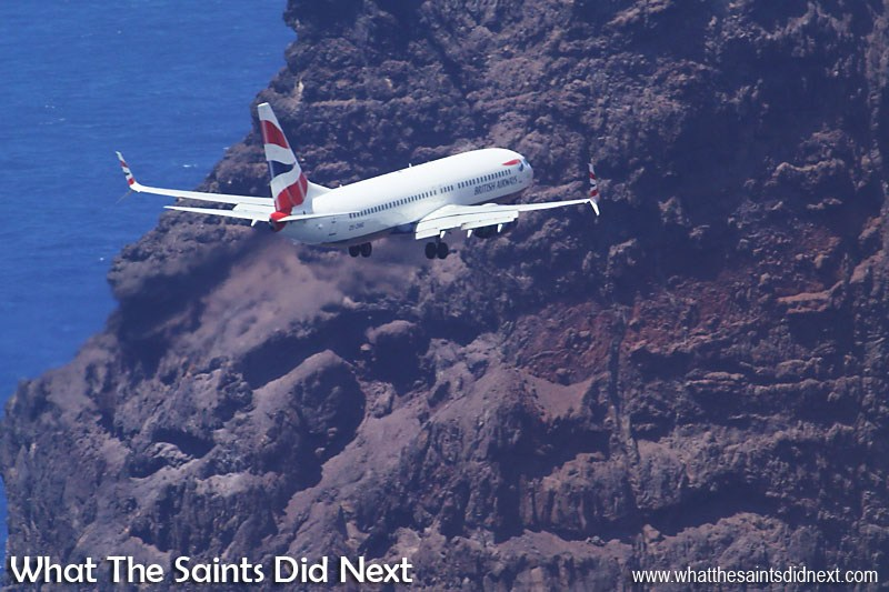 The new St Helena Airport is built in the shadow King & Queen Rock which provides a dramatic backdrop for the British Airways 737-800 as it approaches the beginning of the runway.