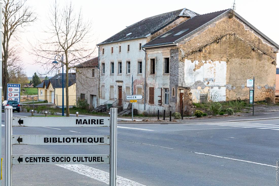 Évrange town, France. Деревня Евранж, Франция. Road signs - Mairie. Bibliothèque. Centre socio culturel. Hagen