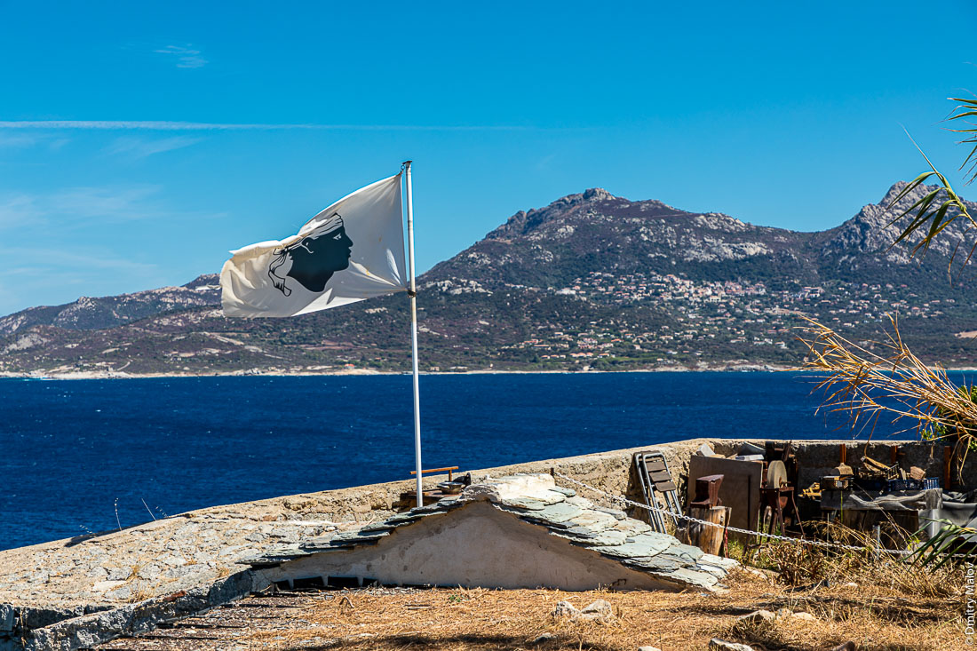 White Corsica flag with Moor's head flying in citadelle of Calve, Corsica