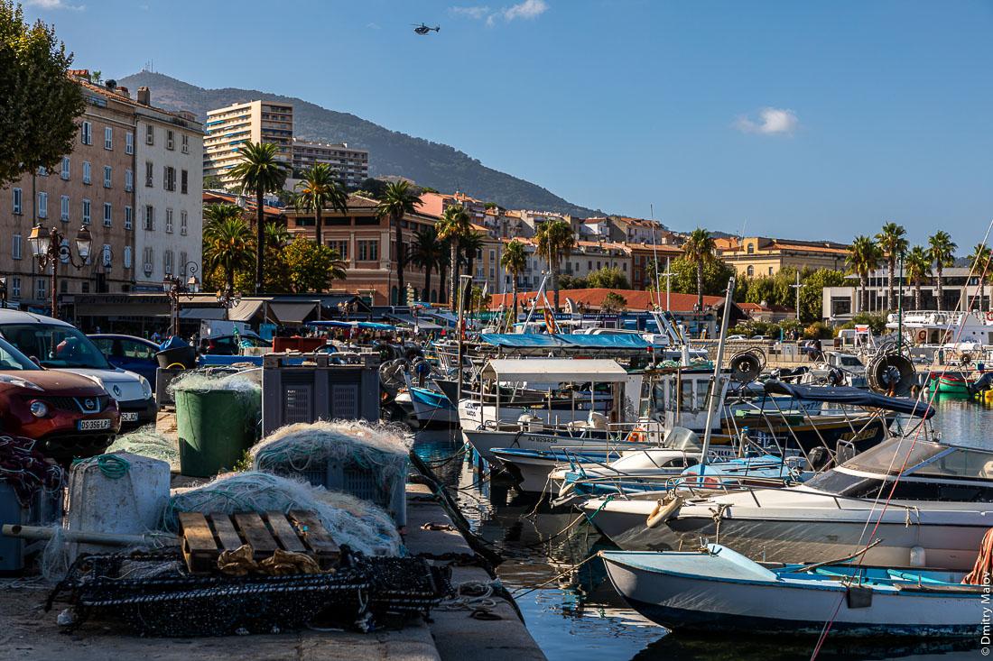 View of Ajaccio seafront from port, military helicopter flying, Corsica. Вид на набережную Аяччо из порта, в небе военный вертолет, Корсика