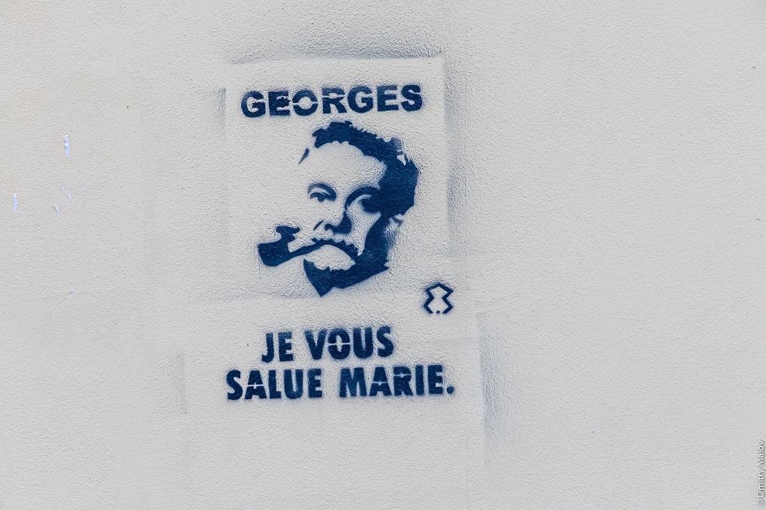 Georges je vous salue Marie. Man's siluette protest graffiti, Ajaccio, Corsica.