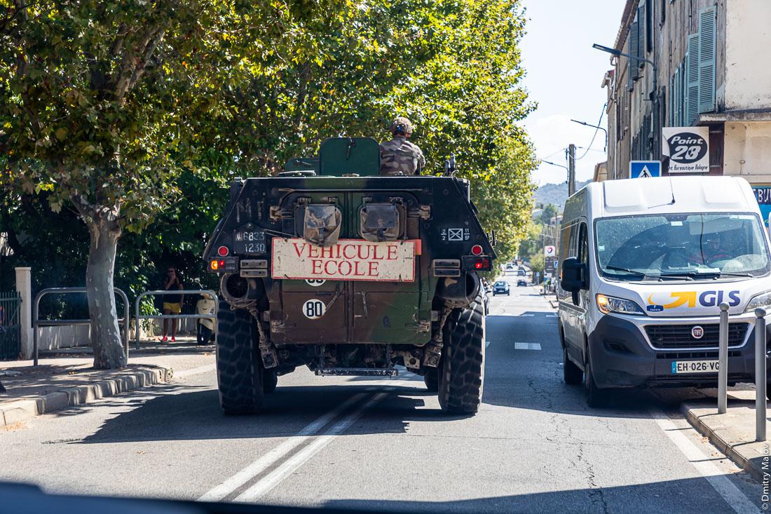 French military armored vehicle driving school on public roads, Corsica. Французский военный бронетранспортер на улицах Корсики